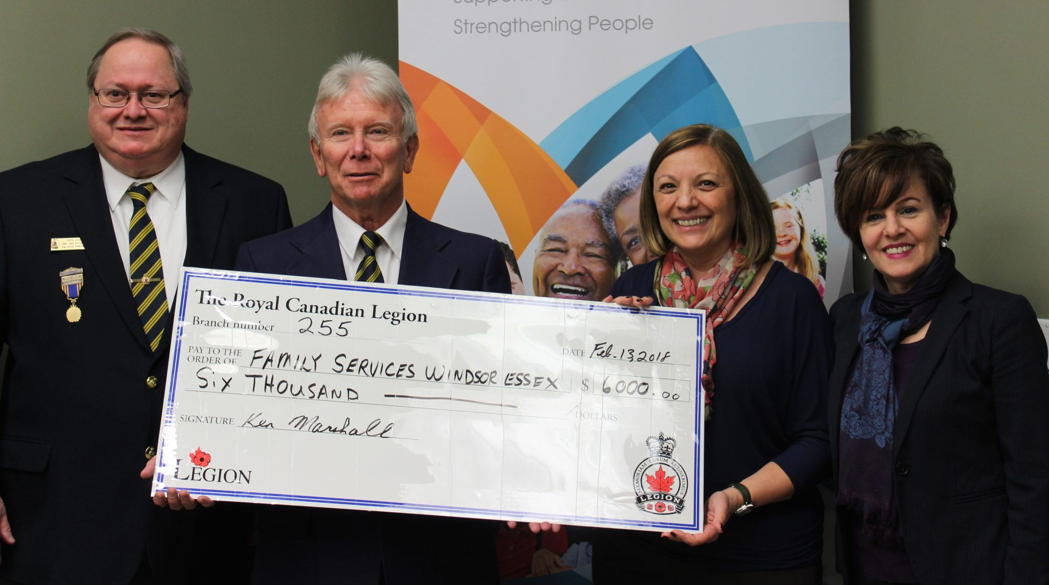 Royal Canadian Legion Members Ken Dault and Ken Marshall holding large $6,000 cheque with Joyce Zuk and Beth Anne Ternovan from Family Services Windsor Essex
