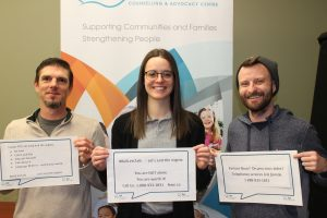 3 FSWE staff holding signs for Bell Let's Talk Day 2019