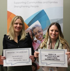 2 FSWE staff holding Bell Let's Talk Day 2019 signs