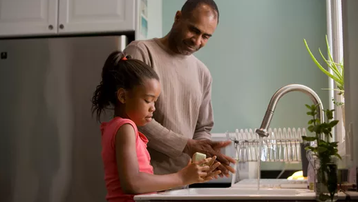 Father and dautogther together in the kitchen