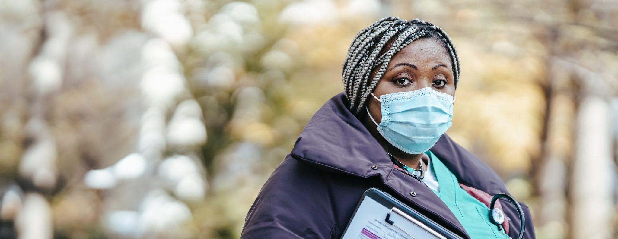 Female Nurse with mask on outside